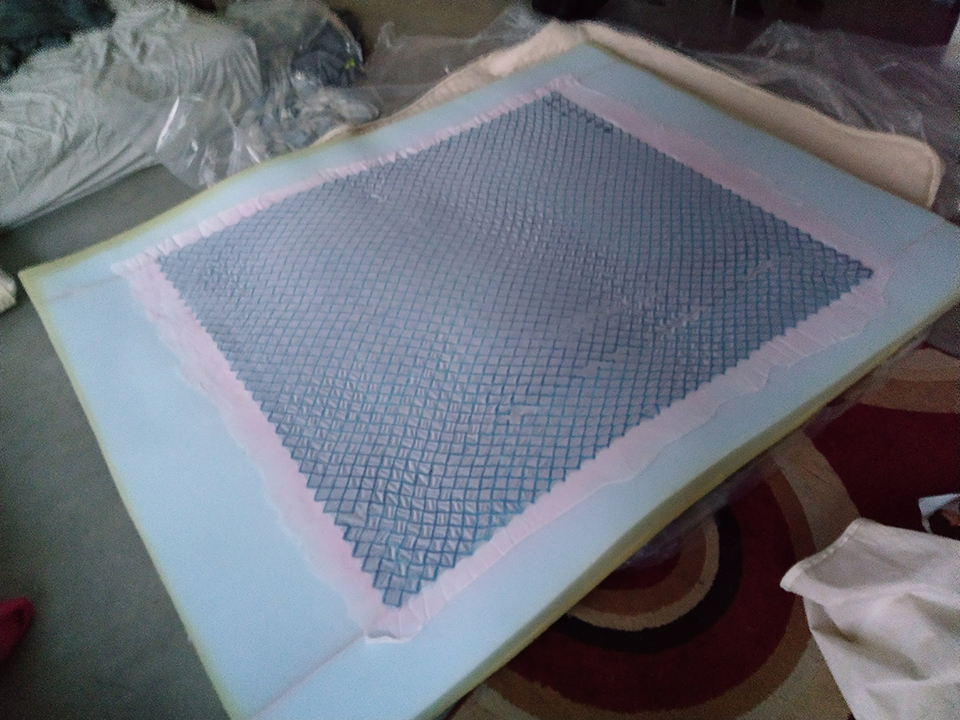 Picture of opened intellibed bed topper with gel in middle and foam around edge