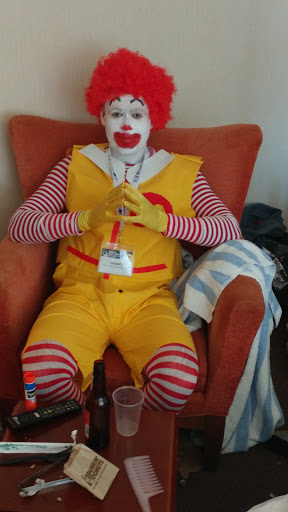 ronald mcdonald costume sitting